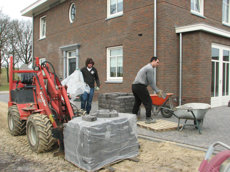 Firm Henk Driessen paving the surface around the house