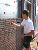 Erik bricklaying the side wall