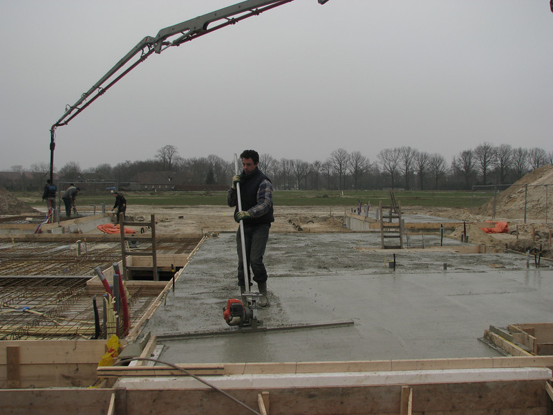 Robert is finishing the concrete floor