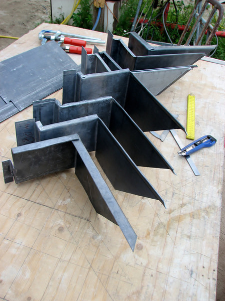 Marijn cutting and bending the sheets of lead. Chimney gable end