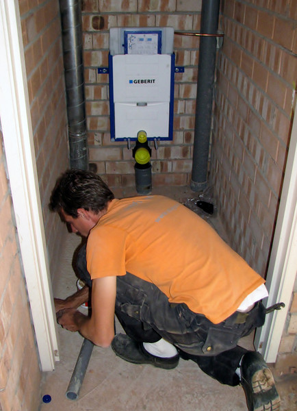 Erick mounting the lavatory and low-flush suite