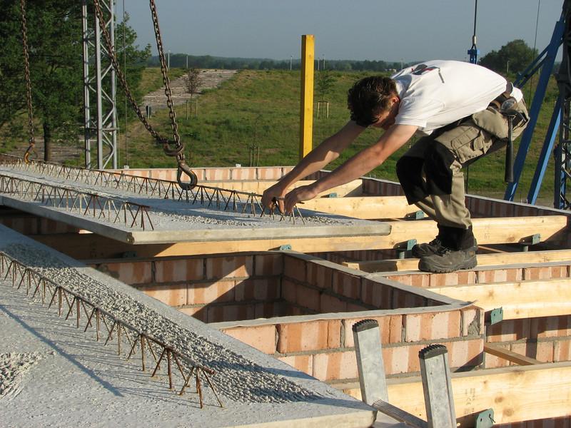 Jarno van Hal adjust the concrete floor elements precisely
