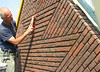 "Scratching out and cleaning the upright course (NL: ""boerenvlecht"") of the gable"