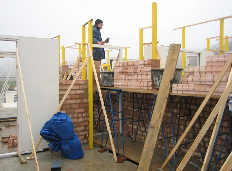Twan bricklaying the interior walls of the ground floor (house)