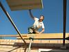 Jarno van Hal adjust the concrete floor elements