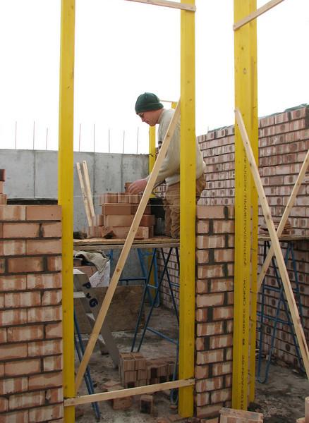 Twan bricklaying the cellar walls