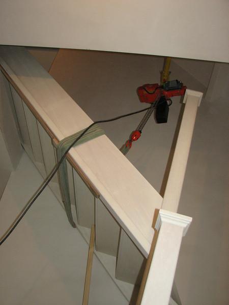 Hoisting the meranti stair of the second floor