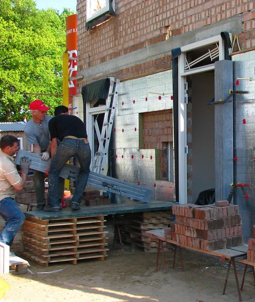 Robert, Frans and Marijn placing the heavy parts of the door frame, 155kg each, Easter 2011