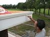 Robert painting the gutter board