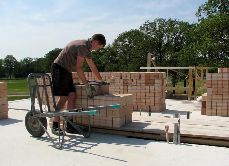 Stijn  dividing the bricks of the attic