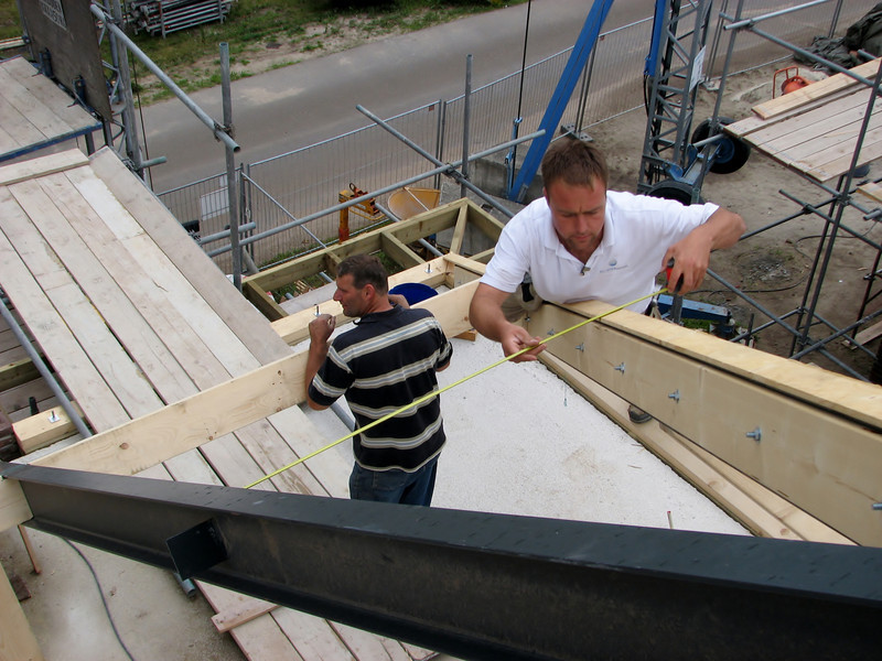 Hans measuring the roof beams