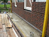 Bricklaying the upright course