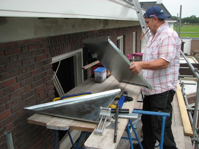 Jeroen making zinc roof parts of the dormer