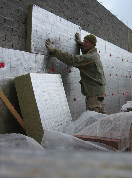 Insulating the garage walls with 85 mm thicknes rock wool,  R declared 2.94 m2K/W,    λ declared 0.033 W/mK (433HP ROCKWOOL)