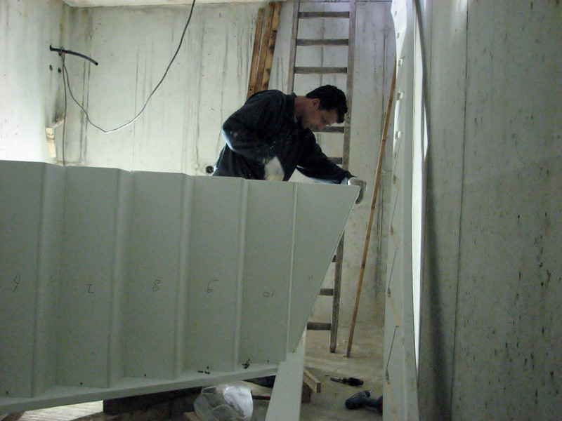Robert and Marijn assembling the staircase of the cellar of the garage