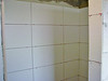 Tiled douche walls