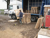 Unloading pallets to store bricks