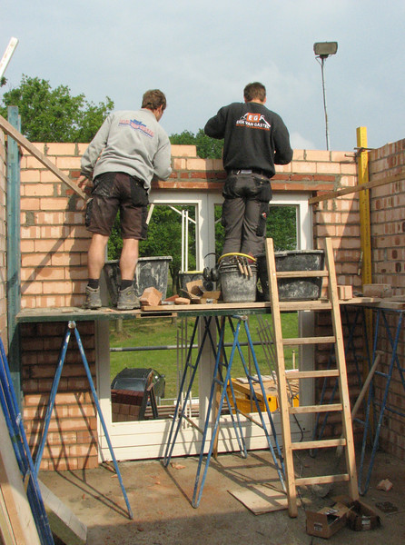 Bricklaying around the doors of the bedroom
