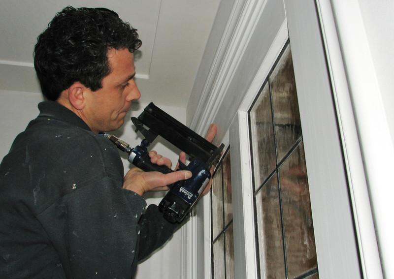 Robert is mounting the leaded windows (firm Robert v.d. Wetering glas- en schilderwerken))