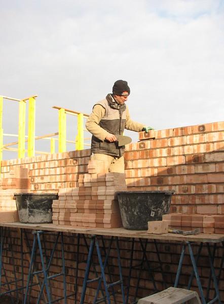 Paul bricklaying the cellar wall