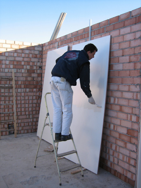 Robert painting the backside of the meter cupboard
