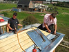 Coen and Jeroen soldering the zinc roof-sheets
