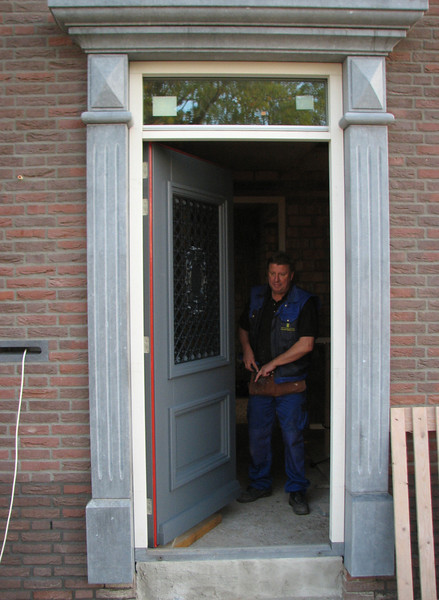 Fixing the front door, weight 94kg, by firm van der Linden
