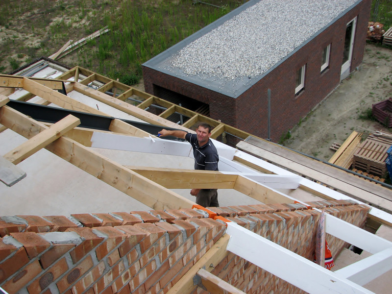 Frans painting the roof beams of nr. 38
