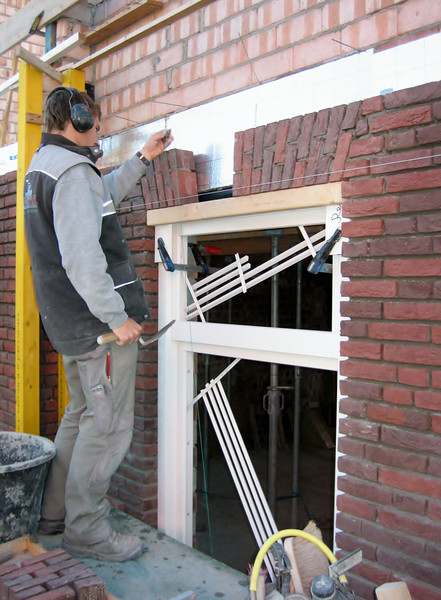 Paul bricklaying the upright course on the front side of the house