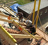 Bricklaying the wall angle and purlines (roof beams)