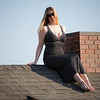 """Emily on top of the cool """"house"""" sculpture."""