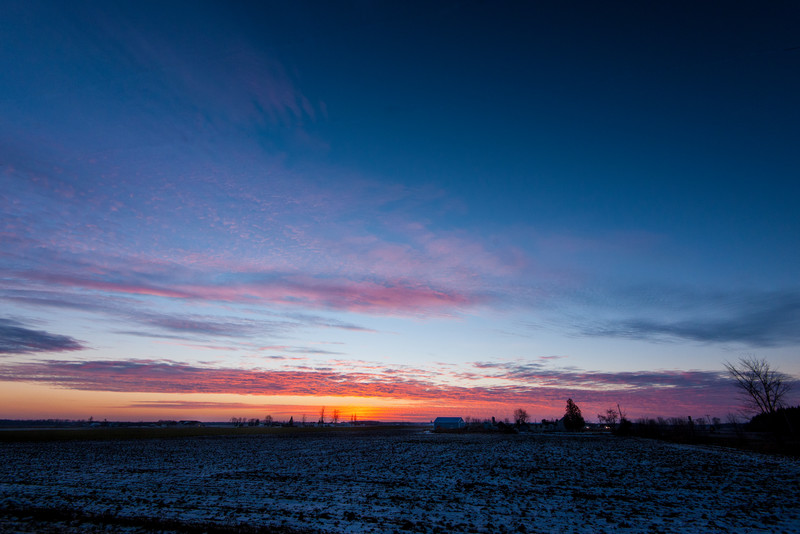 Sunset over the flat farm fields of mid-MIchigan, just south of the Zilwaukee bridge.
