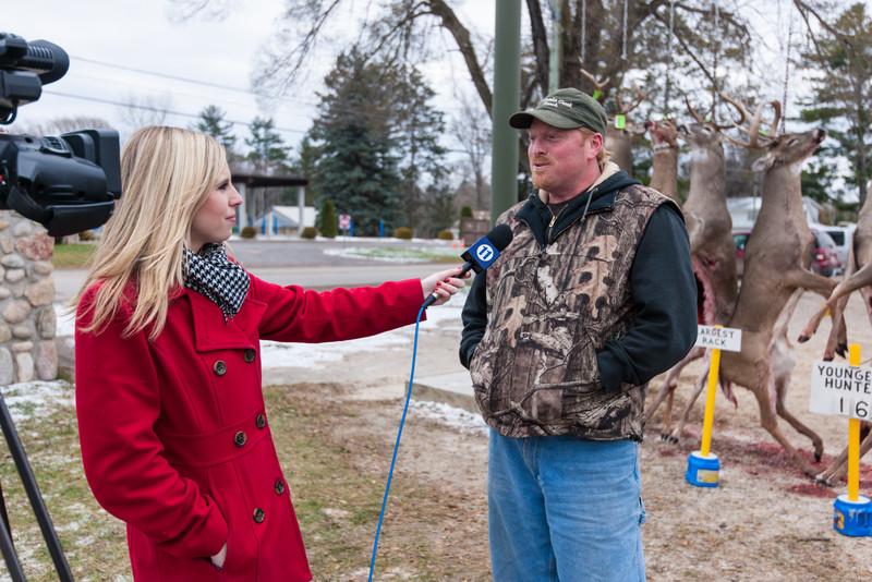 Jessica Starbard, WBKB, Alpena, Michigan, interviews the winner of the Largest Rack at the Atlanta, Michigan Buck Pole, November 15, 2014