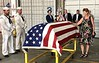 Diane Hanft (nee Klasing), niece, touches the American flag covering Uncle Billy's casket.