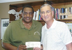 2008 06-30 Americus, GA - Bishop Wallace of Good News Ministries presenting check to Millard Fuller from his annual Kingdom Builders Conference to pay for a house in Nigeria.
