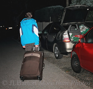04:45 a.m. 2010-08-10  Our son is leaving for the States.  Here he is loading the car so we can get to the airport on time.  My wife says she is planning a 'retirement party' for herself - no more children at home.  Thanks for your thoughts and wishes on Steven's new adventure.  Posting these pictures may have been a bit of closure for me.  At any rate, no more family pix for a while.