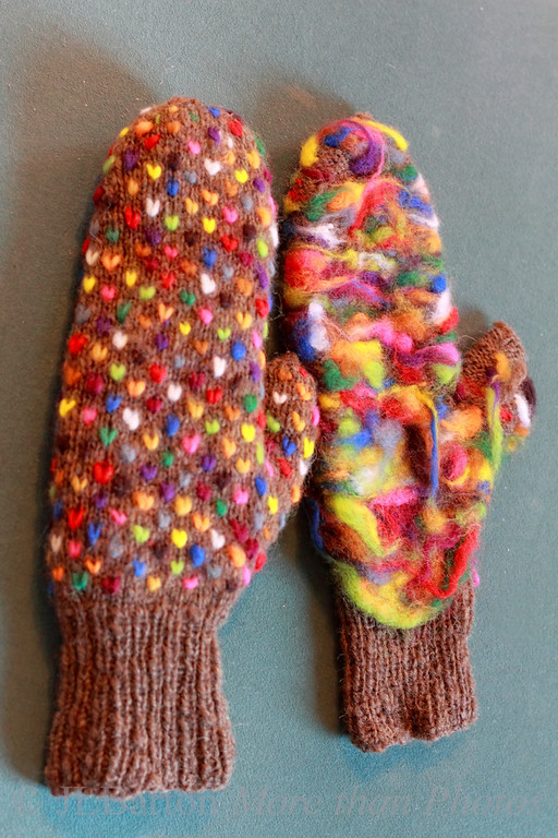 Mittens for Steven His Christmas present, finished by my wife Christmas Eve.  The basic mitten wool is hand spun and knit.  The right-hand mitten is inside out to show the long lengths of wool that were left so they can felt and provide more warmth.  I hope your holidays have been happy so far.