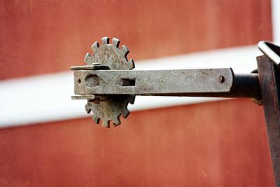 Rusty Gear on Red Barn