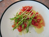 Dry-farmed tomatoes, pea sprouts, olive oil. lemon.
