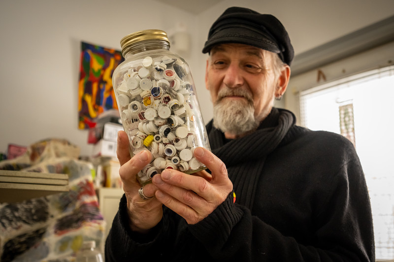 Gerard Pas with his jar of paint tube caps.  February, 2020.