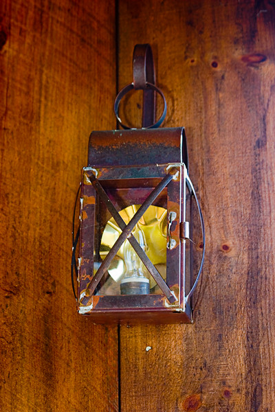 <center>Old Fashioned Lantern<br><br>Glocester, Rhode Island<br><br>I like the style of this old fashioned lantern hanging on the wall of the barn.</center>