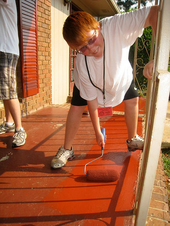 09 06-24 River of Life teen puts fresh coat of paint on weathered front porch in McDonough, GA. ky