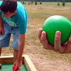 (right) Caleb Cleveland, 13, grips the ball for a toss at the pallino Bball while playing a game of Bocce with Tom Waugaman, 13,  at the new bocce court in Green Springs.<br /> Photo Ben French