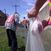 Juvenile offenders in the Sandusky County Youth Works program pick up discarded trash Thursday afternoon along the floodwall in downtown Fremont.<br /> Photo Ben French