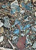 Scraps of rusted metal and glass in defunct gold mining shack.<br /> December 26, 2020
