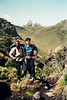 With Evan, guide, ascending trail to Mt. Kenya, visible in the background. Am wearing clothes from Nepal.<br /> June 7, 1994