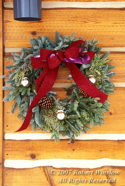 Holiday Wreath on the side of a building, Crested Butte, Colorado, USA, North America