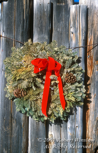 Holiday Wreath on the side of Wooden Fence, Crested Butte, Colorado, USA, North America