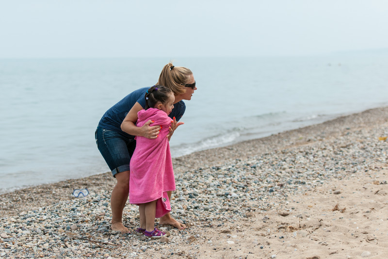 This poor little girl was shivering by the time she was done playing in the (cold) Lake Huron water.