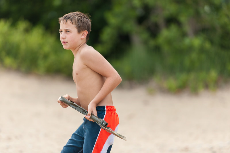 Luke Budnick with the best tool for the job at hand . . . dig up the beach.
